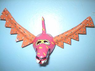 orange and pink vejigante small mask